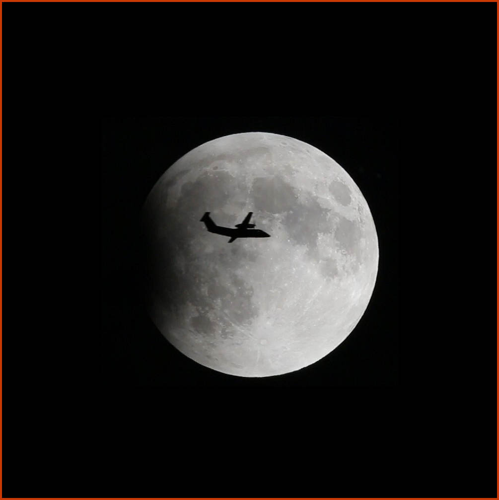 Moon Eclipse and Airplane